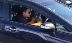 Musician Multitasks on Auckland Motorway