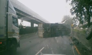 Truck Topples Over After Colliding With Barrier