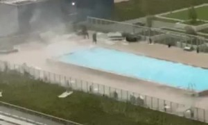 Pool Workers Scramble to Tie down Furniture during Intense Winds