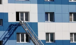 Rescuers Save Child from Falling from Open Window