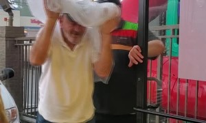 Burger King Employee Protecting Customers From the Rain