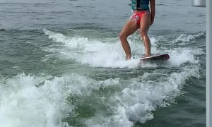 Girl Learning How to Wakesurf Goes Under