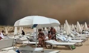 Beachgoers Flee Bad Weather