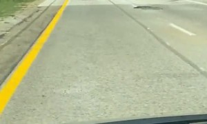 Over-Sized Load Sends Construction Cones Flying