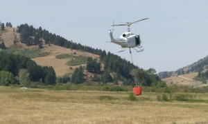 Series of Helicopters Fill Buckets to Fight Bridger Foothills Fire