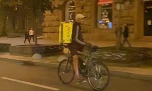 Food Delivery Guy Rides Backward