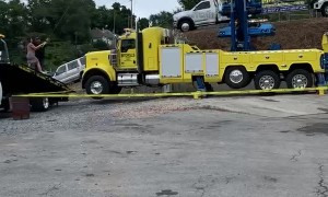 Towing Company Owners Use Crane and Car for Gender Reveal