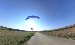 Paramotor Operator Surprises Mountain Board Rider in French Landscape