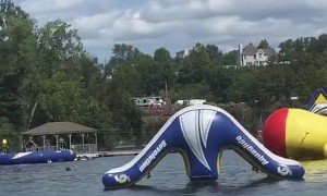 Girl Catches Massive Air from Fat Boy Float at Water Park