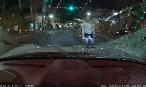 Skateboarder Smashes Windshield