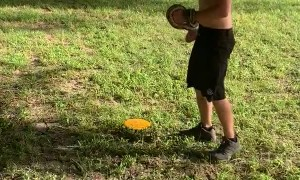 Disk Golfer Rescues Baby Squirrel from Snake