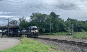 Happy Train Engineer Throws Gift to Railfan