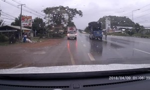 Truck Carrying Big Load Has Close Call on Slippery Road