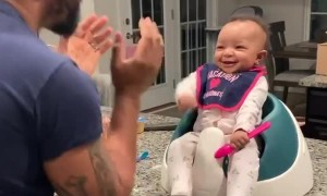 Sweet baby girl laughs at her dad's dance moves