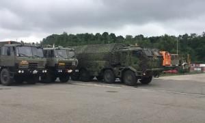 Czech Army Trucks Practice Driving Around Slippery Roads