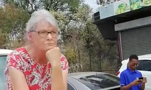 Lady Climbs onto Vehicle After Fender Bender