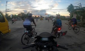 Large Group of Cyclists Ignore Red Light