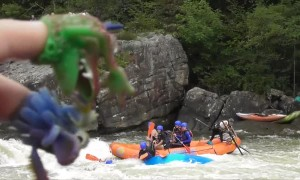 Kayaker Gets Stuck in Front of a Whitewater River Raft