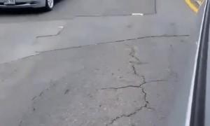 Lady Attempts to Block Traffic in Honolulu