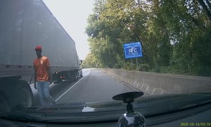 Tailgating Car Swerves into Semi