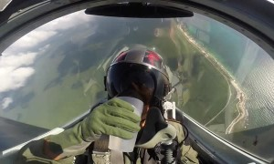 Fighter jet pilot easily drinks water from cup while flying upside down
