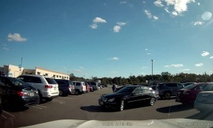 Two Vehicles Backing Out of Parking Spots Collide
