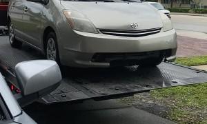 Tow Truck Driver Send Car Rolling Into Garage Door