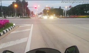 Motorcyclist Has Close Call with Red Light Running Semi