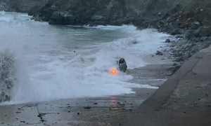 Large Waves Swallow SUV Stuck on Beach