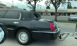 Limo Hauling a Speed Boat