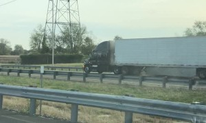 Smoking Semi Continues to Trudge Down Highway