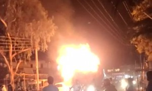 Driver Takes Flaming Tractor away from Town