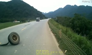 Truck Loses Tire on Curving Road