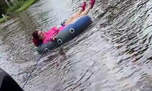 Woman goes tubing in the streets of Florida during Tropical Storm Eta