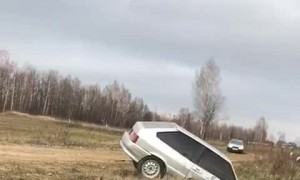 Drifting Car Overcorrects into Ditch