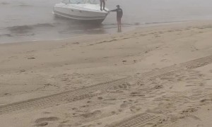 Man Trying to Land a Boat Parallel to the Beach