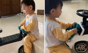 Toddler takes great care cleaning toy car