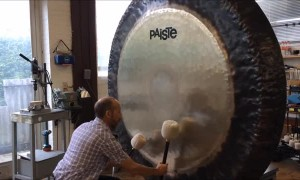 Gong Master Creates Eerie Music on Giant Gong