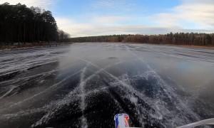 Motocross Rider Drives Across Beautiful Frozen Lake