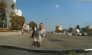 Driver Avoids Peculiar Man in Traffic