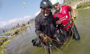 Paragliding Water Touch Ends in Splash