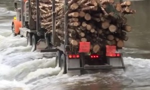 Logging Truck Crosses Flooded Road