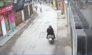 Lady on Moped Drops her Baby Near Oncoming Truck
