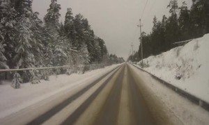 Overtaking Car Slides Into Oncoming Traffic Head-On