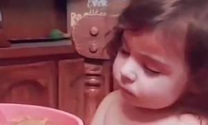 Tired Girl Falls Asleep at Dinner Table
