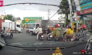 Truck Stops on Top of Motorcycle in Busy Intersection
