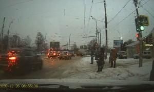 Pedestrian Crossing Street Struck by Passing Car