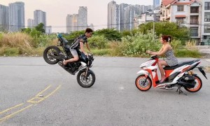 Motorcycle Stunt Ends in a Slam