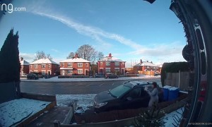 Woman Slips on Slick Driveway