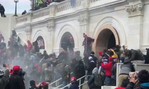 People tear gassed, throwing furniture at the cops